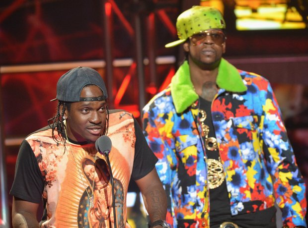 2 Chainz wearing a colourful print jacket