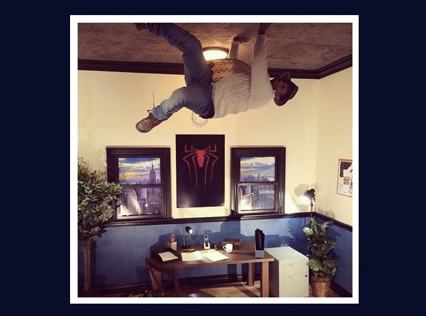 Pharrell Williams like Spider-Man on ceiling
