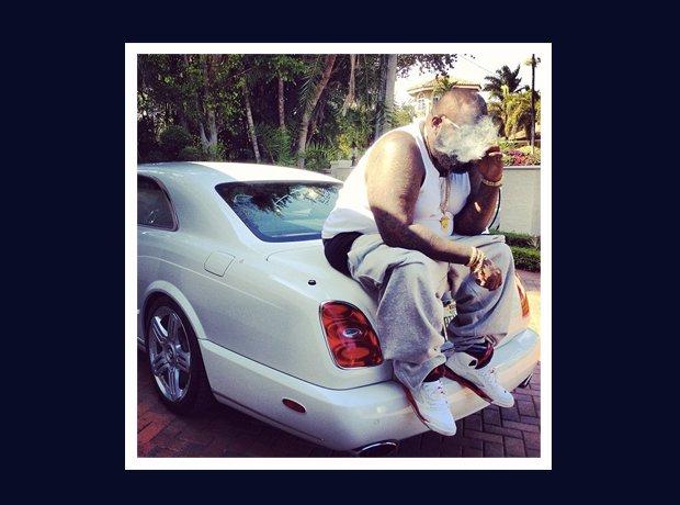 Rick Ross Instagram smoking on car