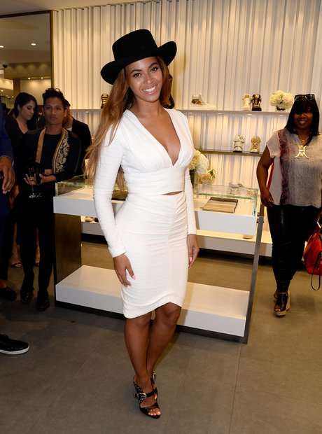 Beyonce wearing a white dress