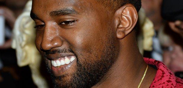 Kanye Smiling red jacket