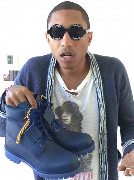 Pharrell Williams holding trainers