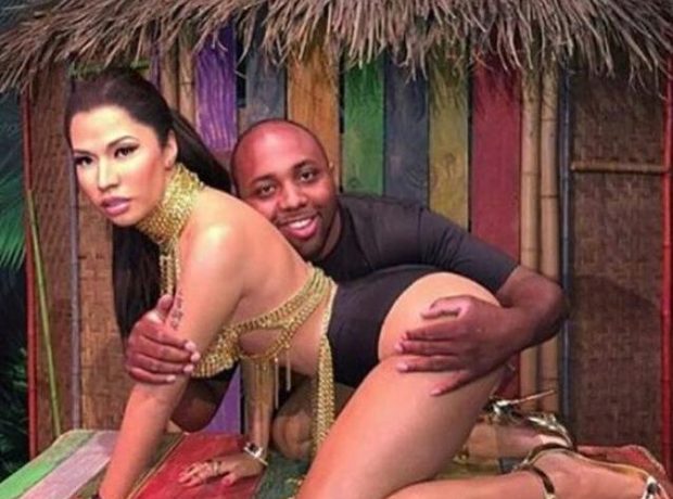 Man hugs Nicki Minaj waxwork
