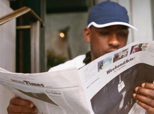 Skepta reading newspaper