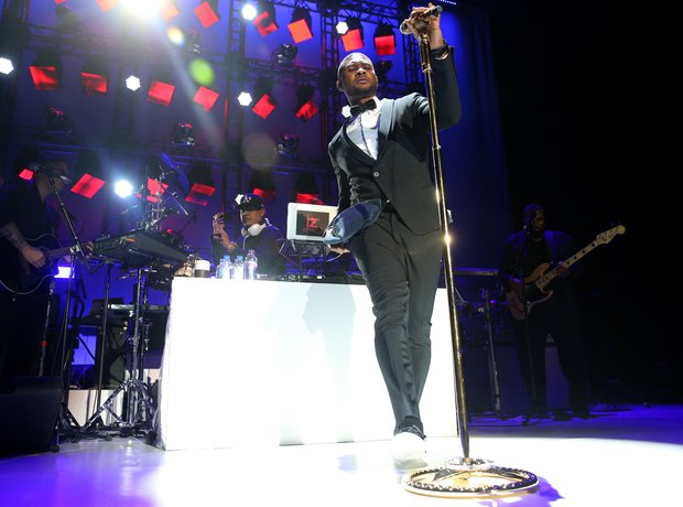 Usher performs on stage at the Samsung Pay New Yea