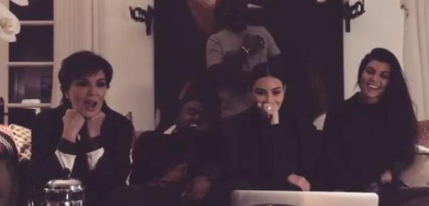 Kanye West and Kardashians on sofa