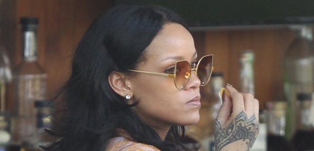 Rihanna chilling out poolside ahead of gig in Miam