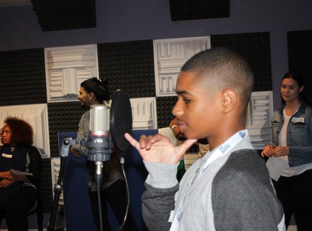 Young person learning about radio